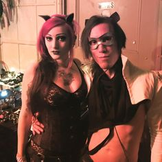 Customer and Rocky wearing our purple cat ears at the Bar Sinister April Birthday Bash