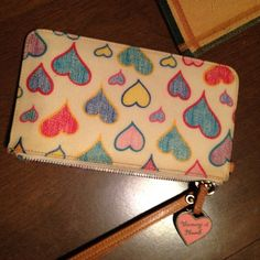 Dooney and Bourne wristlets In excellent condition Dooney & Bourke Bags Clutches & Wristlets