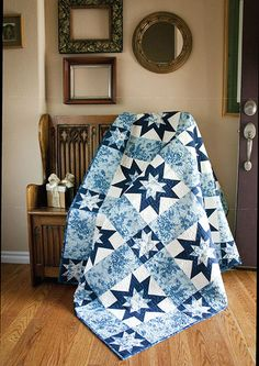 Two variations of the classic Sawtooth Star quilt block twinkle and shine in this frosty tribute to the winter season. Ice Garden, by Sandra Clemons, is simple to piece and a fabulous quilt pattern to show off favorite blue and white fabrics. #TwoColorQuilts #EasyQuilts #BeginnerQuilts #ThrowQuilts