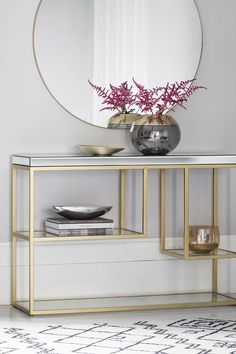 Create a focal point with this stylish yet practical designer Hildebrant console table, featuring a bevelled mirror top and tempered mirrored shelves set into a modern, metal frame.