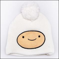 Finn the Human Beanie - This beanie is mostly white with a white ball on the top and a skin coloured face in the middle with black eyes, mouth and border. I just really like adventure time.