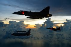 "Royal Thai Air Force SAAB JAS-39C (foreground) and JAS-39D (background) ""Gripens"" escorting a SAAB SF-340AEW AWACS"