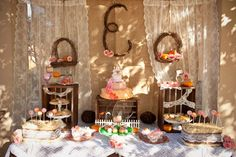 roses and pumpkin pink and orange first birthday party farm dessert table with initial backdrop
