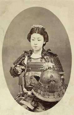 """A rare vintage photograph of an onna-bugeisha, one of the female warriors of the upper social classes in feudal Japan.    Often mistakenly referred to as """"female samurai"""", female warriors have a long history in Japan, beginning long before samurai emerged as a warrior class."""