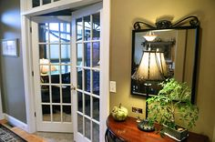 French doors lead to a den in a home in Central New York