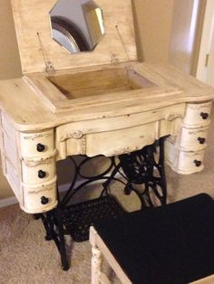 Treadle sewing machine that's been repurposed into a vanity and refinished using Anne Sloan chalk paint and then lightly distressed.