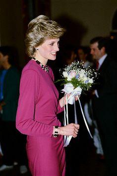1980-1990, Westminster, London, England, UK --- Princess Diana receives bouquet of flowers at a Supertramp concert.