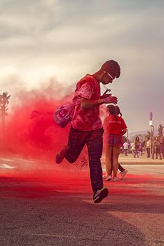 Red dust - Young people celebrate Holi color festival in Malaga, Spain.
