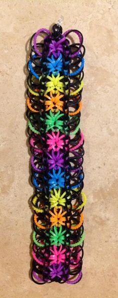 Rainbow Loom STARBURST with rings. Original bracelet design by Rainbow Loom. Adapted and loomed by Nicole van Hek-Riphagen‎, Rainbow Loom FB page, 05/28/14.