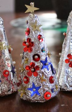 Christmas Craft--styrofoam cones covered in aluminum foil and decorated with small push pins and sequins...CUTE