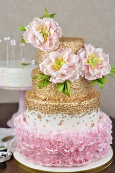 Let your cake decorating skills bloom with a step-by-step tutorial on how to make and arrange a stunning floral cake topper!