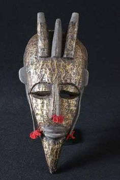 Bambara Mask |  The Bambara or Bamana are Mali's largest ethnic group.  The Bambara had its glory in the early 17th  century, when Kaladian Coulibaly founded the empire of Segou, a kingdom that was one of the dominating forces in the region.  Bambara masks represent different manifestations of Faro, the creator god and guide of the universe, who gave all the qualities to men and who grows the fruit of the earth. So the mask is directly involved in the ceremonies, and its power is still…