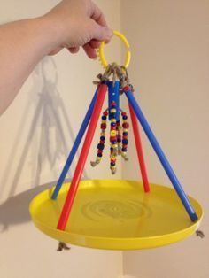 ♥ Pet Bird Cage Ideas ♥  Parrot toy made with a frisbee, XL straws, beads, sisal rope and a baby toy link for hanging. Found on The Parrot's Workshop on facebook