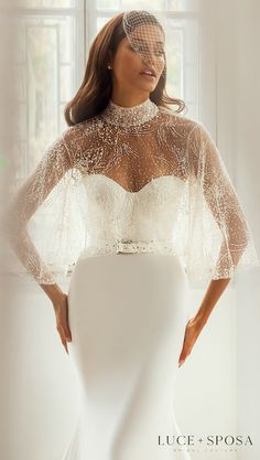 Simple mermaid wedding dress with strapless sweetheart neckline and belt, and a beaded cape for the minimalistic bride | Glamorous bridal accessories | Luce Sposa Wedding Dresses 2021- Joanna - Belle The Magazine #weddingdress #weddingdresses #bridalgown #bridal #bridalgowns #weddinggown #bridetobe #weddings #bride #dreamdress #bridalcollection #bridaldress #dress See more gorgeous bridal gowns by clicking on the photo