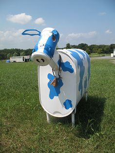 Metal cow by the side of the road - photo by tackyjulie, via Flickr