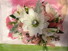 Glam up your corsage with some crystal accents inserted into the centre of flowers!