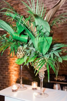 This glam gold and black tropical wedding is filled with exotic elegance. It's an indoor tropical paradise of palm trees, exotic flowers and striking gold details with pops of teal and fuchsia. Bridal Party Tables, Wedding Tables, Tall Gold Vases, Gold Wedding, Wedding Flowers, Party City Balloons, Teal Party, Tropical Paradise, Tropical Art