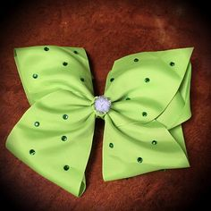 Tinkerbell Peter Pan Disney Princess Large Rhinestone Green Cheer Hair Bow  Large Green Grosgrain Bow, Decorated with Green Rhinestones & White Silver PomPom Centrepiece  Mounted on an Alligator Clip  Looks Great Paired with the Tinkerbell Choker:  https://www.etsy.com/uk/listing/485422416/tinkerbell-peter-pan-disney-princess