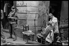 By Nicolas Tikhomiroff In the Casbah district, French troops stand guard, always on the lookout for possible riots. Algiers, 1960.