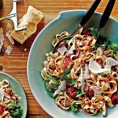 Tagliatelle with Sausage, Tomatoes and Arugula.