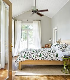 A botanical-themed duvet cover by Dwell Studio tops a Crate & Barrel bed in one guest room of this Texas ranch. The walls are painted Spanish Olive by Benjamin Moore.      - CountryLiving.com