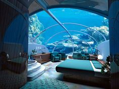Stay in the underwater hotel. Jules' Undersea Lodge in Key Largo, Florida. This is one of the weirdest theme hotels in America. Guests need scuba training—offered on site—to check into this hotel's underwater suites. Hotel Subaquático, Dubai Hotel, Dubai Uae, Dubai City, Hotel Decor, Hotel Suites, Beautiful Hotels, Beautiful Places, Amazing Places