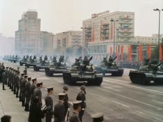 East German Army T-55 main battle tanks rolling down Karl-Marx-Allee in Berlin at the 1979 German Republic Day Parade.