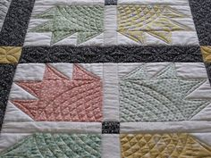 Bear's Paw Quilting ideas..  Needs more in background and sashing.