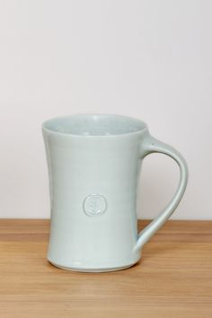 Glazed porcelain mug, designed and handmade in Cornwall by Leach Pottery. It's decorated with a Chinese style ying ching glaze for a beautiful finish. #SeasaltComfortandJoy