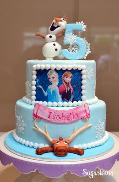 Disney Frozen cake. Elsa and Anna edible image, handmade Olaf and Sven from fondant. Made by Sugartown. www.facebook.com/sugartownsydney