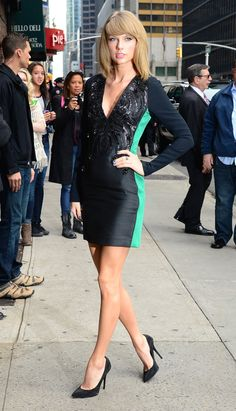 Taylor Swift wears Antonio Berardi navy and teal sequin dress with matching sparkly Giuseppe Zanotti pumps at David Letterman