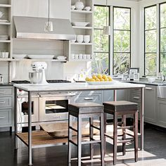 Contemporary kitchen.  Open shelving, steel windows, and white.