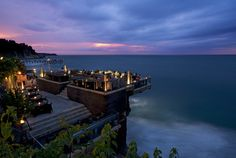 Rock Bar, South Kuta, Indonesia - The Rock Bar at the Ayana Resort & Spa has become one of the icon of Bali's new wave of luxurious resorts that incorporate modern architecture with the natural beauty of the island. The bar teeters over the edge of the precipitous cliffs facing out into Jimbaran Bay, which is one of the best places in Bali to watch the sun sink into the Indian Ocean.