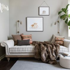 tuften linen Victorian Roll Arm Upholstered Daybed with bohemian accent pillows and jungle-themed prints & exotic faux fur throw