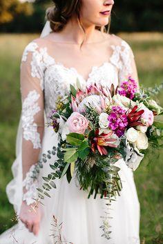 Fall bridal photo shoot at The Grove! #HannahHigginsPhotography see more at www.thegroveaubreytexas.com #BridalPortraits #FallWedding #ProteaBouquet #LongSleeveBridalGown #TheGroveTX #NorthTexasBride #Engaged