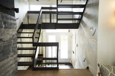 Home to Win Season 3 entryway black staircase going up two levels and white French doors Black Staircase, Rise And Run, Season 3, Hgtv, Home Buying, French Doors, Interior And Exterior, Tours, Bed