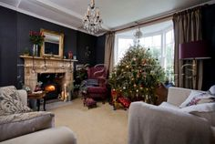 Google Image Result for http://www.narratives.co.uk/ImageThumbs/RG011_21/3/RG011_21_Christmas_tree_in_bay_window_of_dark_grey_living_room_in_Tenterden_family_home__Kent__England__UK.jpg