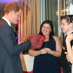 Having a laugh: Prince Harry meets Lauchlan Dougall, 11, who gave the Royal a Tam o' Shanter hat