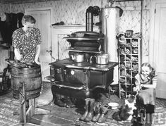 """Federal B cook-stove - """"An old woman working in the old fashioned kitchen while the young girl plays with her kitten"""" Photograph by Bernard Hoffman, Maine, Source: LIFE Photo Archive, Vintage Pictures, Old Pictures, Old Photos, Old Kitchen, Vintage Kitchen, Kitchen Decor, Kitchen Sink, Kitchen Ideas, Alter Herd"""