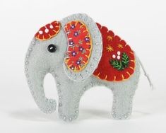 Handmade felt elephant ornament for Christmas or any occasion. Made from grey felt with hand-embroidered details in a range of colours.Please choose red, orange