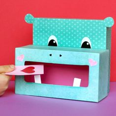 Easily craft up an adorable hippo Valentine box using recyclables and a little creativity.