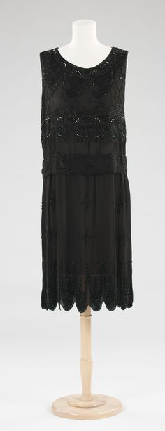 """Evening Dress: ca. 1927, French (probably), silk, rhinestones. """"In 1924, Vionnet introduced her Little Horses dress, decorated by heavy beading applied in a special manner to her bias cut dress. The beads were arranged to move with the fabric and the design was an interpretation of the horses found on Grecian vases. The dress seen here is a copy of this well-known design, which was particularly appealing and highly sought after..."""""""