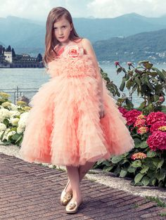 It's time to forget floral print and upgrade to floral appliqué. Girls striking peach dress by Junona, with masses of tulle layers. It has a beautiful, removable, rose appliqué