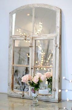 Door mirror {put old mirrored window for top of my chandelier in the new outdoor kitchen}