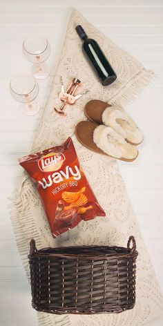 Looking for the perfect Christmas gift for friend? With winter coming, everyone needs the essentials for a cozy night in! Just fill a gift basket with a bottle of wine, wine glasses, a wine opener, a warm blanket, comfortable slippers and Lay's Wavy Hickory BBQ… and then invite yourself over to enjoy it with them. Cheers!