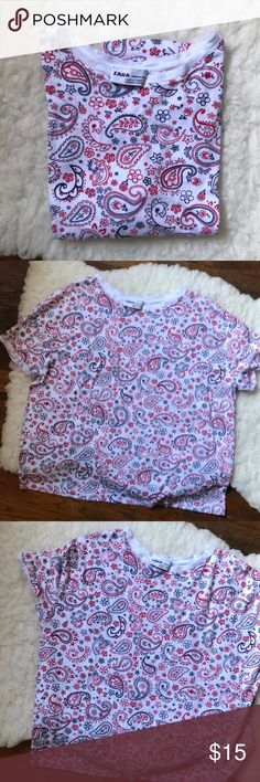 Zara paisley print white tee This top looks vintage to me based on the tag.  It is missing the fabric content tag but it feels mainly like cotton. May fit a medium large based on measurements. Please look at pictures for details and measurements. Zara Tops Tees - Short Sleeve