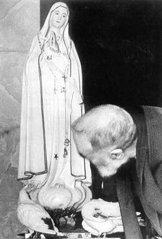 """Padre Pio kisses the statue of Our Lady of Fatima. He said, """"May Jesus always be the pilot of the little boat of your spirit. May Mary be the star which shines on your path and may she show you the safe way to reach the Heavenly Father."""""""