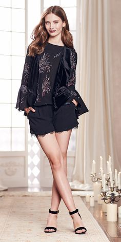 Give your frocks the night off and opt for  lace-trimmed shorts instead. With bell sleeves and a dark floral print, this feminine blouse features a split open back for extra intrigue. Shop the complete LC Lauren Conrad Runway Collection at Kohl's.