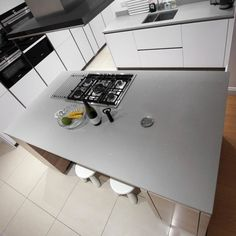 This is the Grigio De Lusso. A grey style version of our popular white quartz with small diamante flecks throughout. You can see the glisten from above! Grey Style, White Quartz, Grey Fashion, Kitchen Island, Popular, Canning, City, Island Kitchen, Popular Pins