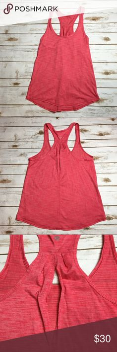 Coral pink cutout back Lululemon tank This Lululemon tank is a coral pink color. It had a small vertical cutout in the upper part of the racerback. I ❤️ offers! lululemon athletica Tops Tank Tops